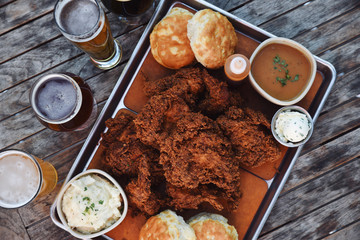 Platter of deep fried meat, sauce and ale