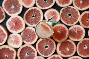 Sliced blood oranges and drink