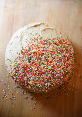 Cake, frosted and sprinkled