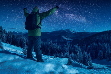 Hiker against starry night sky