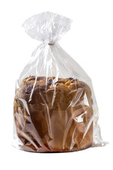 Panettone in plastic bag isolated over white