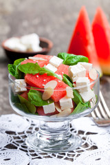 Salad  with fresh watermelon and feta with basil and spinach lea