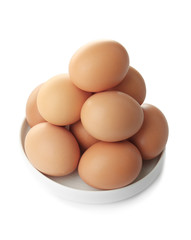 Raw eggs in plate on white background