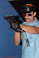 Policeman shooting his pistol - Stock image