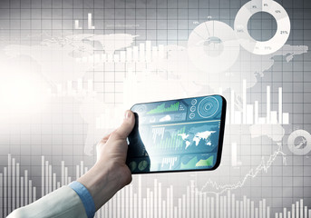 Media technology concept presented by businessman holding tablet with graphs and diagrams