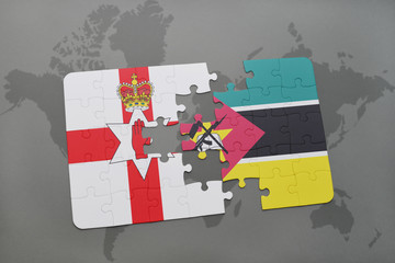 puzzle with the national flag of northern ireland and mozambique on a world map