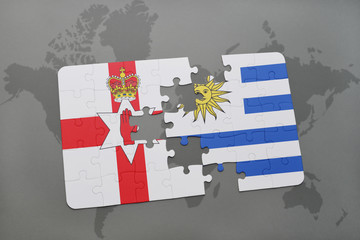puzzle with the national flag of northern ireland and uruguay on a world map