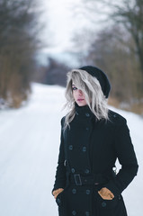 Beautiful gray haired hipster girl on winter road