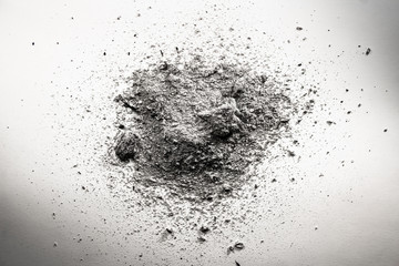 Pile of grey ash, dirt, sand, dust cloud, death remains