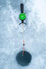 Ice-hole and rod for winter fishing.