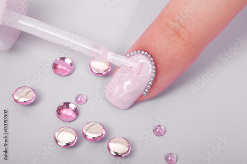 Manicure in beauty salon finger with nail design closeup for 33 fingers salon