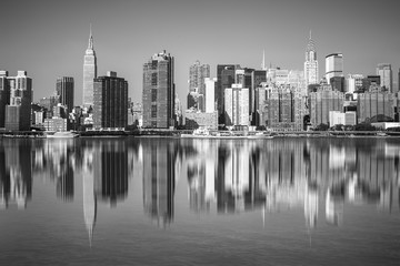 Wall Mural - New York City view of Manhattan and The East River with reflections of NYC buildings in black and white
