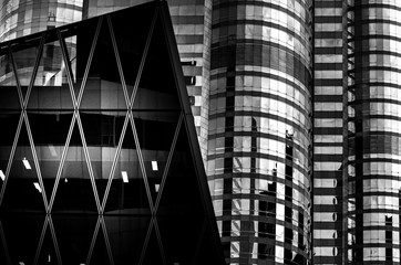 Office buildings stretch up to the sky with B&W color