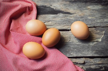 Chicken egg on old wooden background