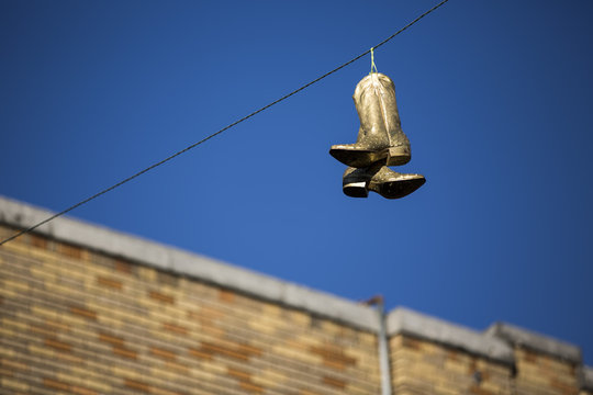 Golden boots on a wire