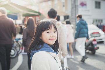 Beautiful Asian girl walking in the city,Tsukiji fish market ,Tokyo Japan.