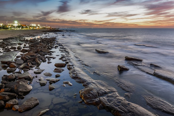 Colorful scene after sunset along the coastline of Nahariya, long exposure