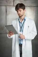 Young doctor with tablet pc