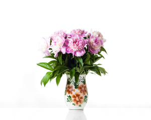 Bouquet of beautiful  pink peony flowers in decorative rustic style pot. Floral design wallpaper