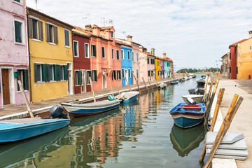 Colorful houses lining the canal (Burano, Italy)