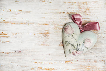 valentines day or wedding background with shabby chic heart and copy space. love concept