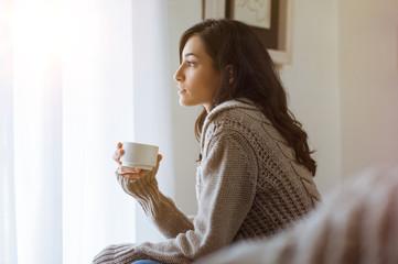 Woman thinking at home