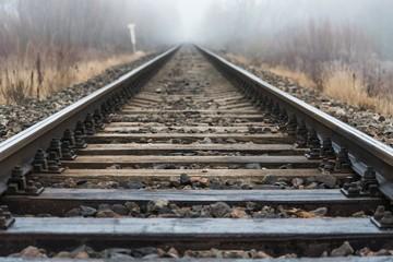 Wall Murals Railroad Empty railroad track going into a fog, outdoor landscape