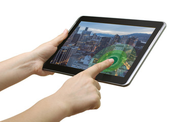Closeup of a hand touching the screen Internet Tablet at the table. Business concept, people search, and the concept of web technology.