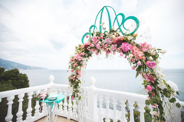 Wedding arches in the Tiffany color. Sea. The ocean.