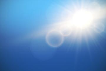 Sun with lens flare on blue sky, vector.