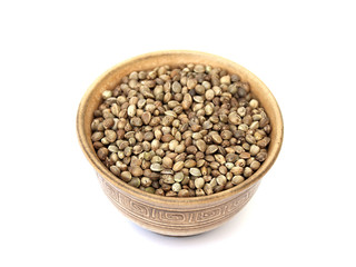 hemp seed in a bowl on a white background