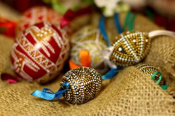 Handmade Easter eggs on coarse burlap cloth background