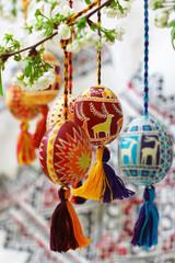 Easter eggs on spring of flowering tree.