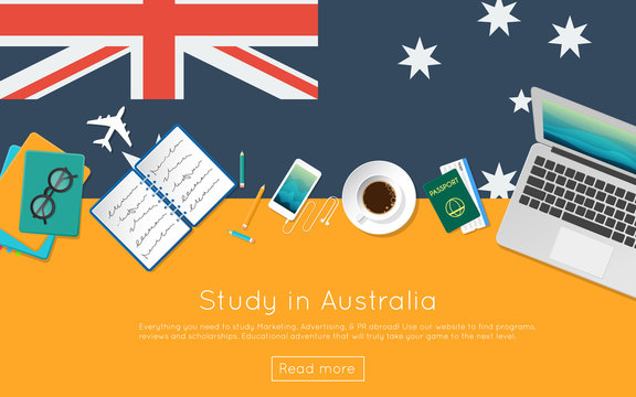 Study in Australia concept for your web banner or print materials. Top view of a laptop, books and coffee cup on national flag. Flat style study abroad website header.
