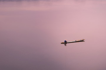 paddle on the calm ocean/sea alone. sunset with twilight