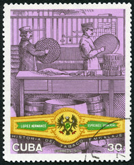 CUBA - 1970: shows Packing cigars Lopez Hermanos band