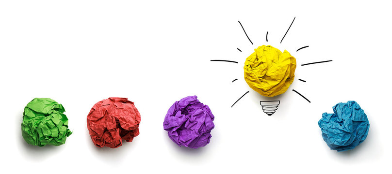 Great idea concept. Crumpled paper as a lightbulb isolated on white