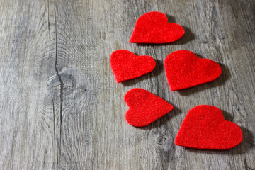 A decorative red hearts on gray wooden background