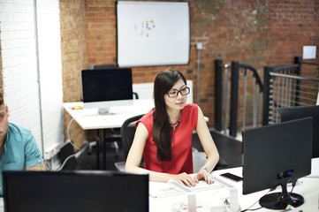 Asian businesswoman at her desk in an office