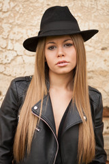 Blonde young woman with black hat