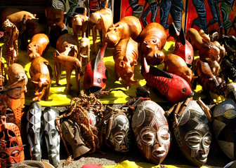 African wooden and stone souvenirs masks and wild animals. Local market. South Africa.