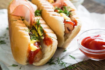 Hot dogs on a wooden table