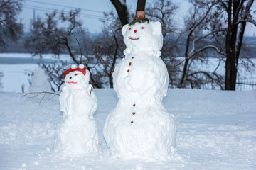 two snowman on a park