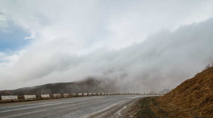 Thick fog on a mountain road.