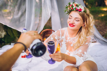 Portrait of cute couple drinking wine on picnic