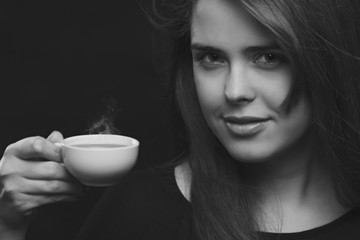 portrait of a woman with a hot drink coffee