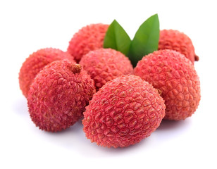 Sweet lychees fruits with leaves.