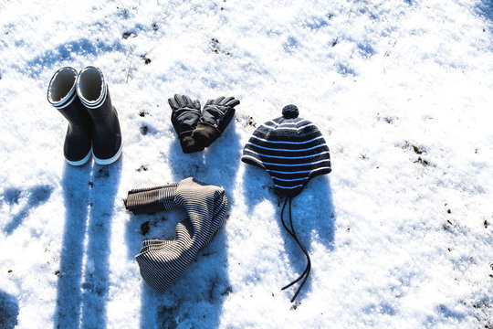 Winter gear laying on snow