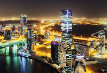 Amazing nighttime skyline: skyscrapers of a big modern city. Downtown, Dubai, United Arab Emirates. Colorful cityscape.