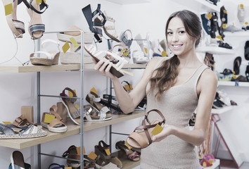 young woman in shoes store.